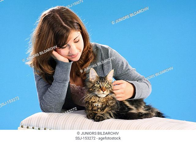 young woman - fondling Maine Coon cat