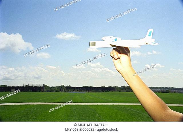 Hand holding glider