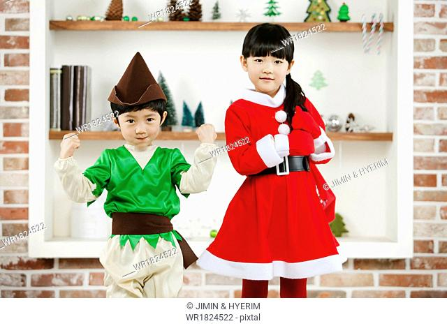 A boy and a girl wearing costumes