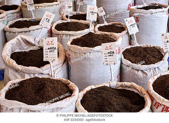 China, Yunnan, Xishuangbanna, tea shop at market