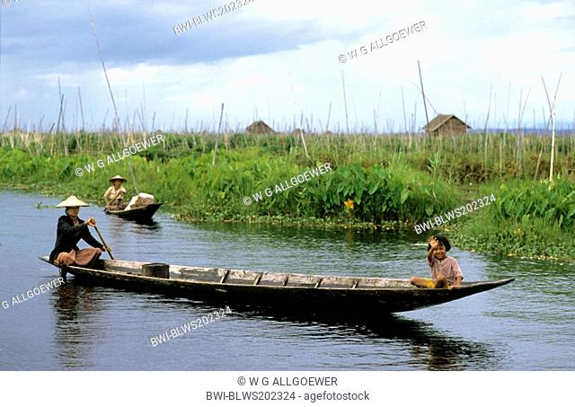 mother and daughter in a longboat on Inle Lake, Burma
