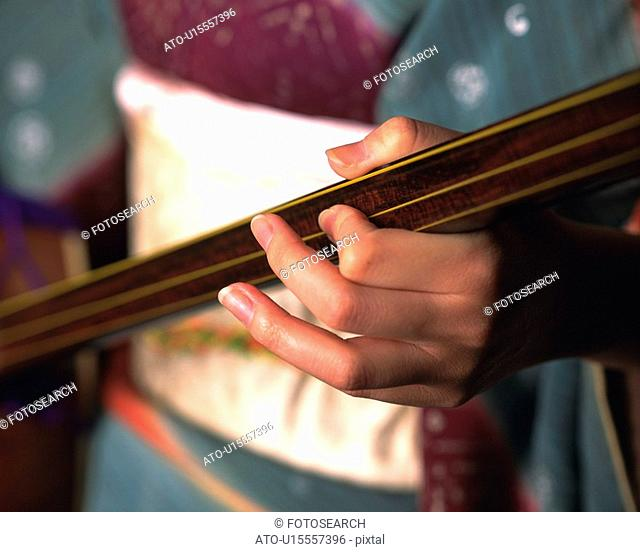 A hand of woman in kimono playing shamisen, High Angle View, Close Up, Differential Focus
