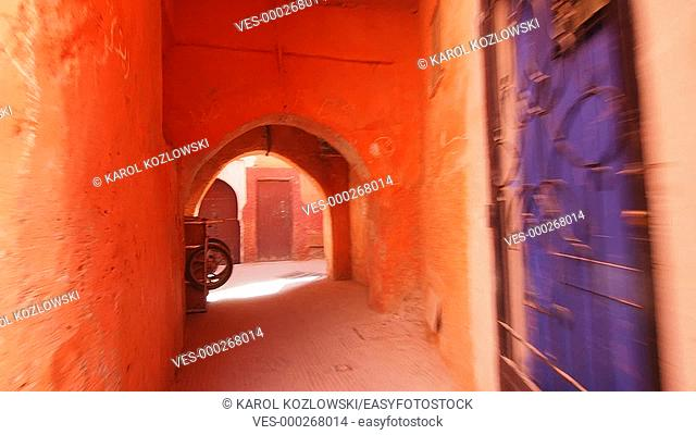 Walking through the narrow streets of the old medina in Marrakesh, Morocco, Africa