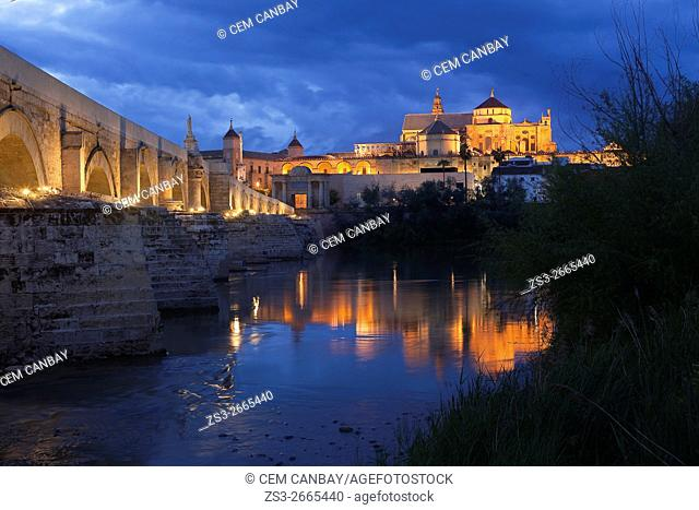 View to the Guadalquivir river and Roman bridge with the Cathedral and Great Mosque at the background in historic centre of Cordoba, Andalucia, Spain, Europe