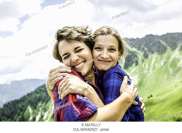 Two female friends hugging, Tyrol, Austria