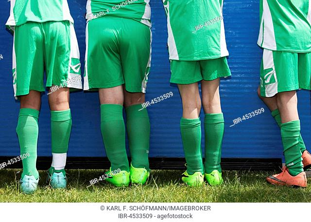 Four players of a youth football team, rear view, North Rhine-Westphalia, Germany