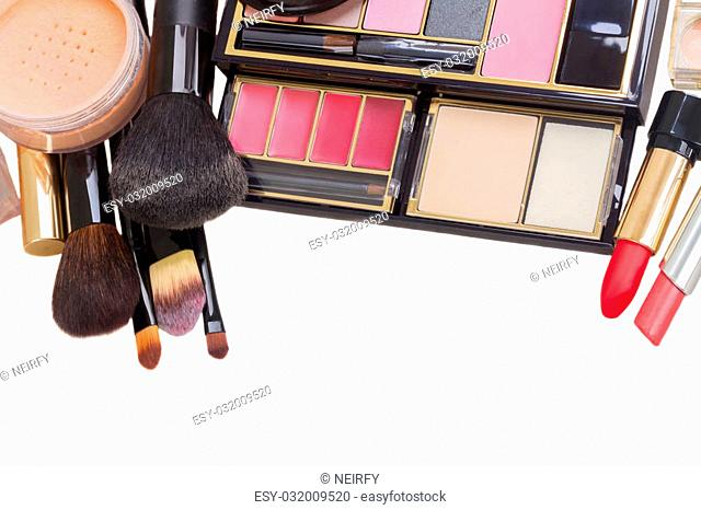 make up products and brushes isolated on white background