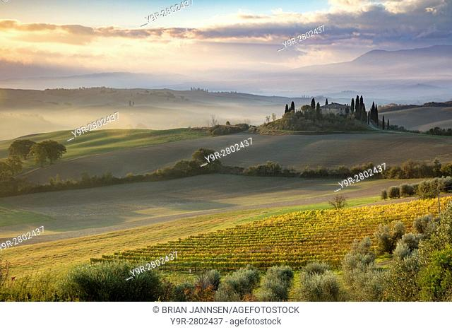 Sunrise over the Belvedere and countryside of Val d'Orcia near San Quirico d'Orcia, Tuscany, Italy
