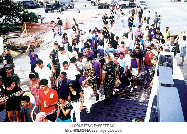 Cuban migrants at Guantanamo Bay Naval Base assembling for their flight to Homestead Air Force Base Florida where they will be admitted to the U.S