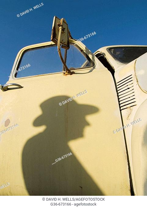 Shadow of man at farmer's market in Baywood Park, California