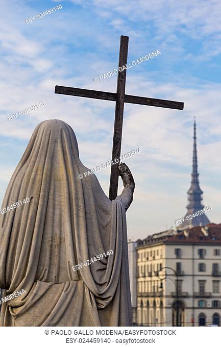 Religion Statue with cross - located in front of Gran Madre Church, Turin