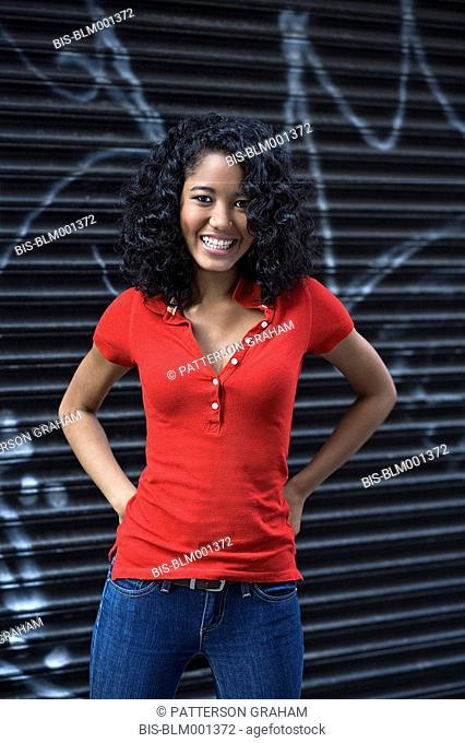 Mixed race teenage girl in urban setting