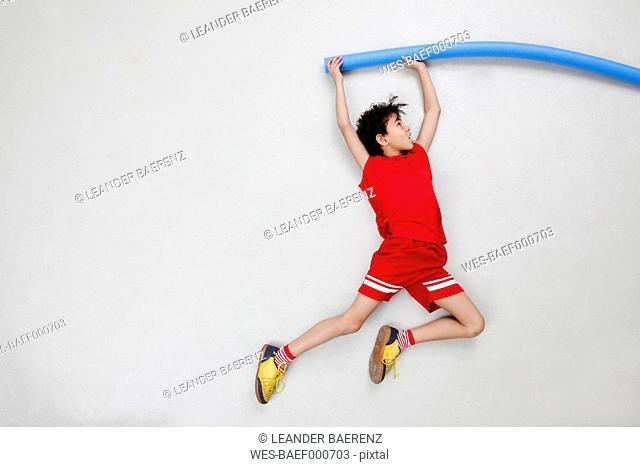 Boy doing pole vault