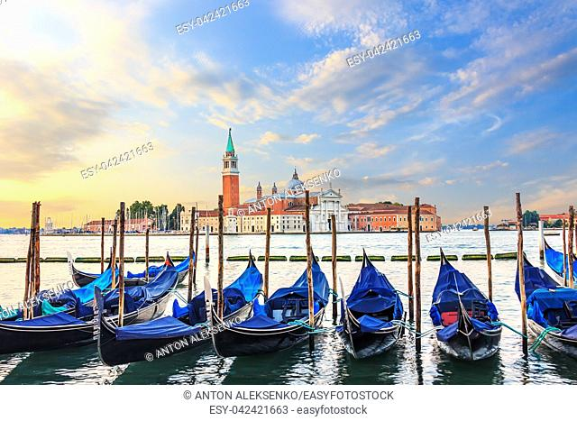 Gondolas moored at the pier in Grand Canal with San Giorgio Maggiore in the background, Venice, Italy