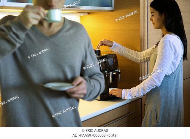 Couple enjoying coffee in kitchen