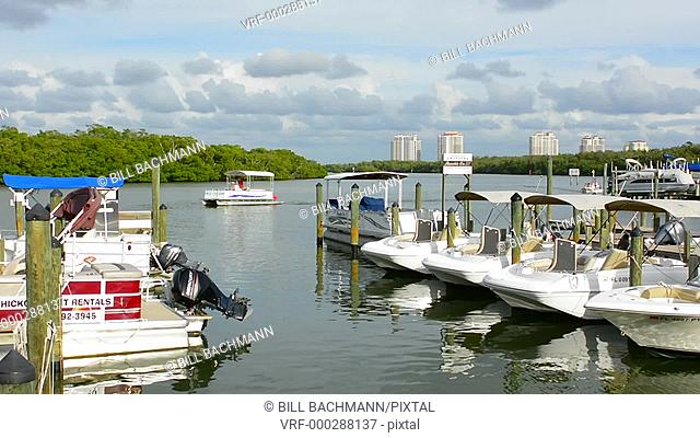 Bonita Springs Florida Big Hickory Marina with boats on intercoastal waters in bay relax restaurant