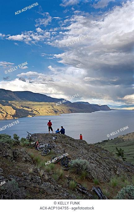 A group of mountain bikers takes a break over Kamloops lake, west of Kamloops, Thompson Okanagan region, British Columbia, Canada