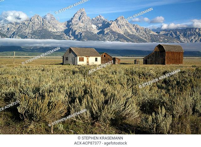 Scenic of Teton Mountain Range and historic buildings from the T.A. Moulton Ranch on Mormon Row in Grand Teton National Park, Jackson, Wyoming, North America