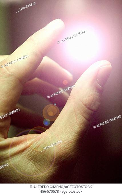 Fingers holding light