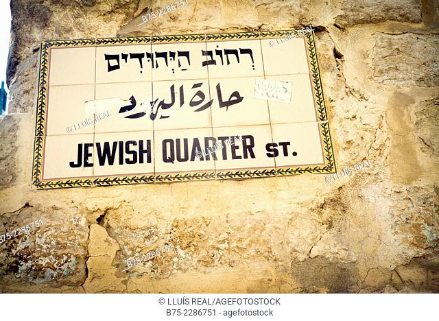 Ceramic plate on a facade announcing the Jewish Quarter in Jerusalem, capital of Israel, written in English and Hebrew