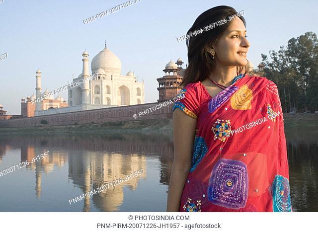 Woman with a mausoleum in the background, Taj Mahal, Agra, Uttar Pradesh, India
