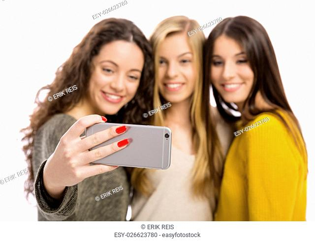 Teen girls with smartphone taking selfie