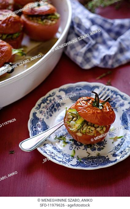 And oven-roasted tomato with a vegetable and spelt filling