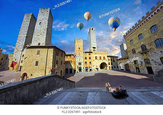 Hot Air Balloons over the Piazza Duomo (Cathedral Square) of San Gimignano with its medieval towers built as defensive towers and also to show the families...