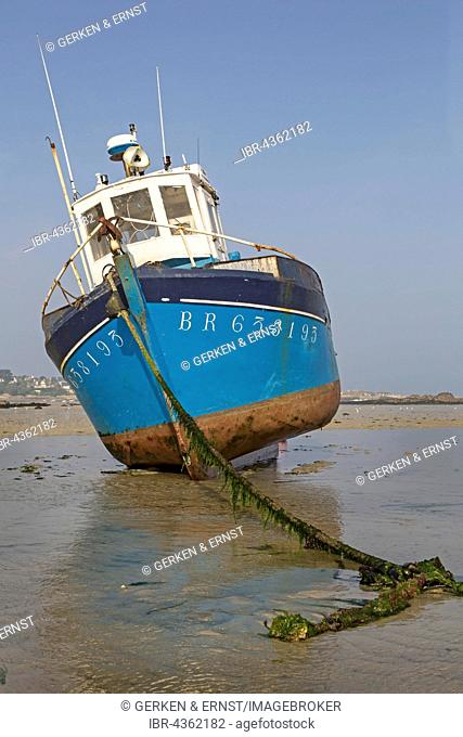 Fishing boat in the intertidal zone, Brittany, France