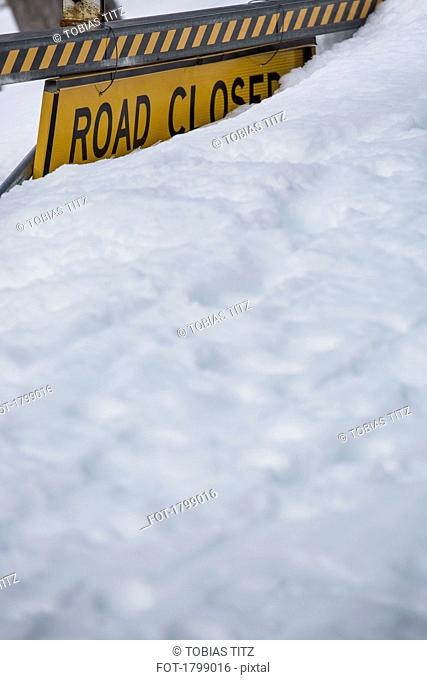 Snow covering Road Closed sign