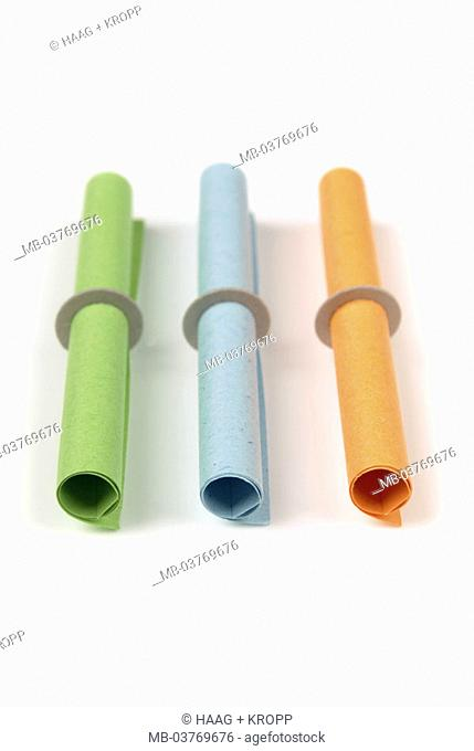 Profit game, lots, colorfully,  rolled up, three, side by side   Papers, little papers, colorfully, colors, different,  differently, roles, small rolls, symbol