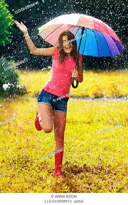 Young and beautiful woman have fun in rain Debica, Poland