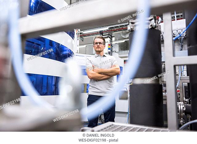 Confident man in factory shop floor