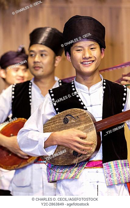 Zhaoxing, Guizhou, China. Young Men Playing the Pipa, a Lute, in a Traditional Musical Performance by Members of the Dong Ethnic Minority