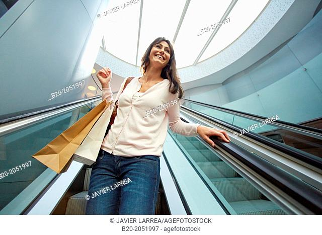 35 year old woman on escalators. Shopping at the Bretxa Market. Donostia. San Sebastian. Gipuzkoa. Basque Country. Spain