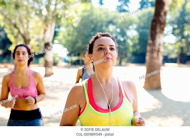 Friends jogging in park
