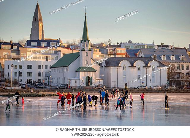 Playing ice hockey on the pond in Reykjavik, Iceland