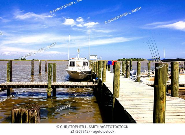 Small boats tied up along the Apalachicola Estuary in Florida leading to the Gulf of Mexico
