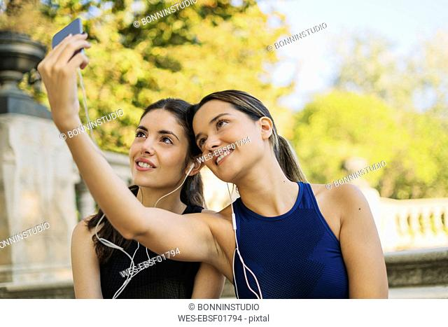 Two sportive young women taking a selfie