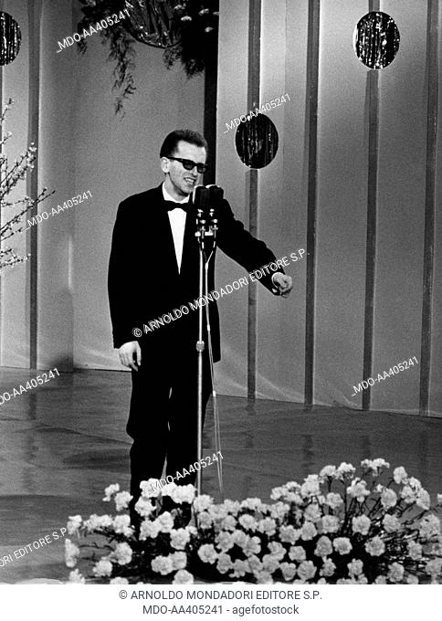 John Foster at the 15th Sanremo Music Festival. Italian singer and journalist John Foster (Paolo Occhipinti) taking part in the 15th Sanremo Music Festival