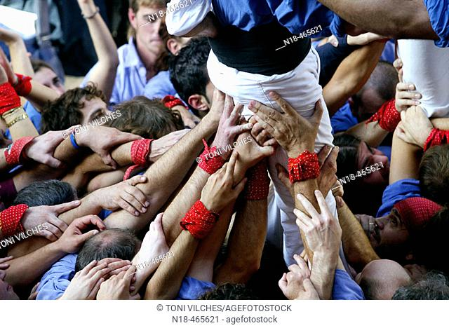 'Castellers' building human towers, a Catalan tradition. Girona, Catalonia, Spain