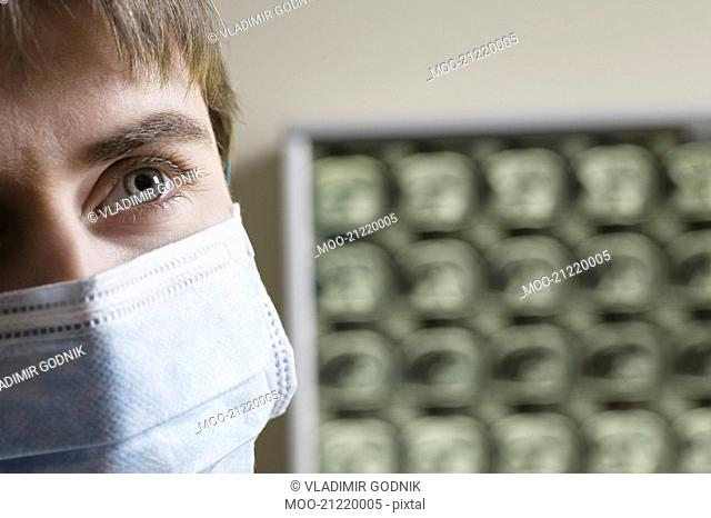 Doctor wearing surgical mask close-up