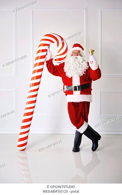 Santa Claus with handbell and candy cane