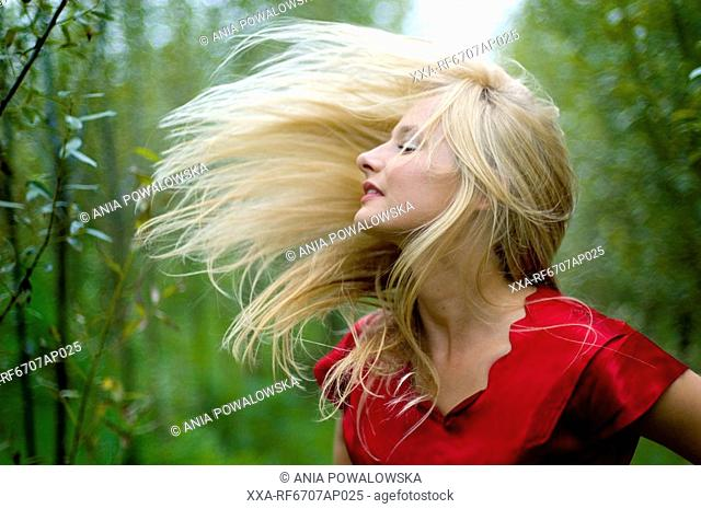 Young woman with wind blown hair
