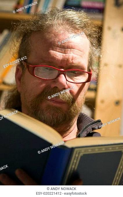 man with book in front view