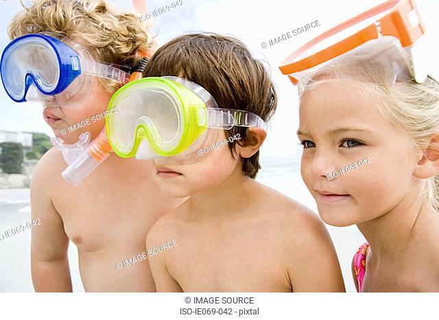 Kids wearing diving masks