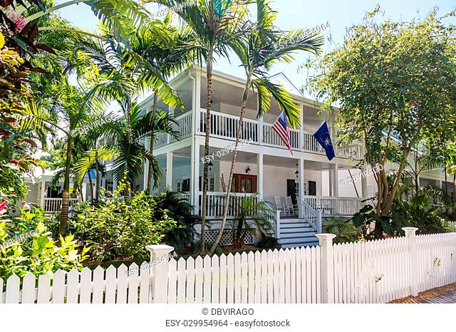 Traditional wood siding home in Florida with American flag