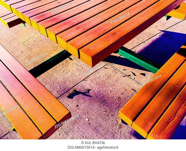A modern bench in a park, Ontario, Canada