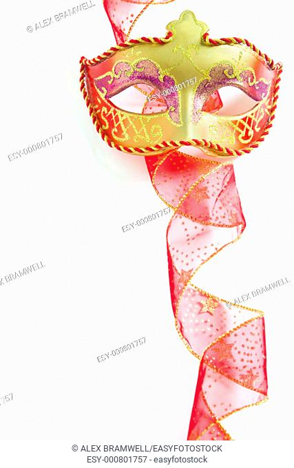 Fancy dress mask and red ribbon  Nice for a Christmas party invive with no cliched baubles