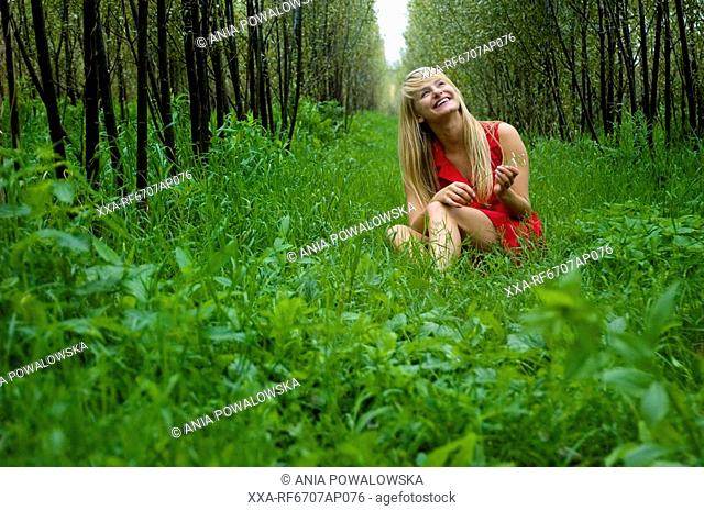 Young woman relaxing in forrest